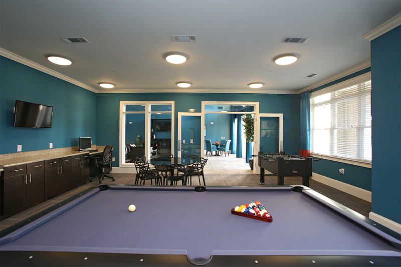 Gaming room with a pool table and foosball table