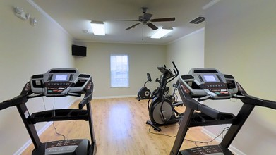 Ashton Mill fitness center with treadmills and ellipticals