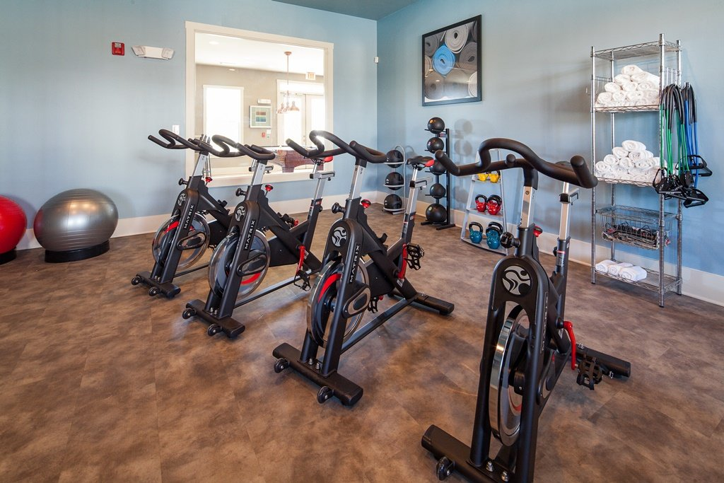 Ansley Town Center fitness center with spin bikes, kettlebells, and medicine balls.