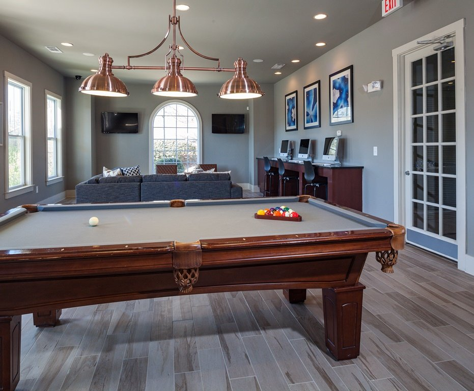 Interior of the clubhouse at Ansley Town Center with a pool table