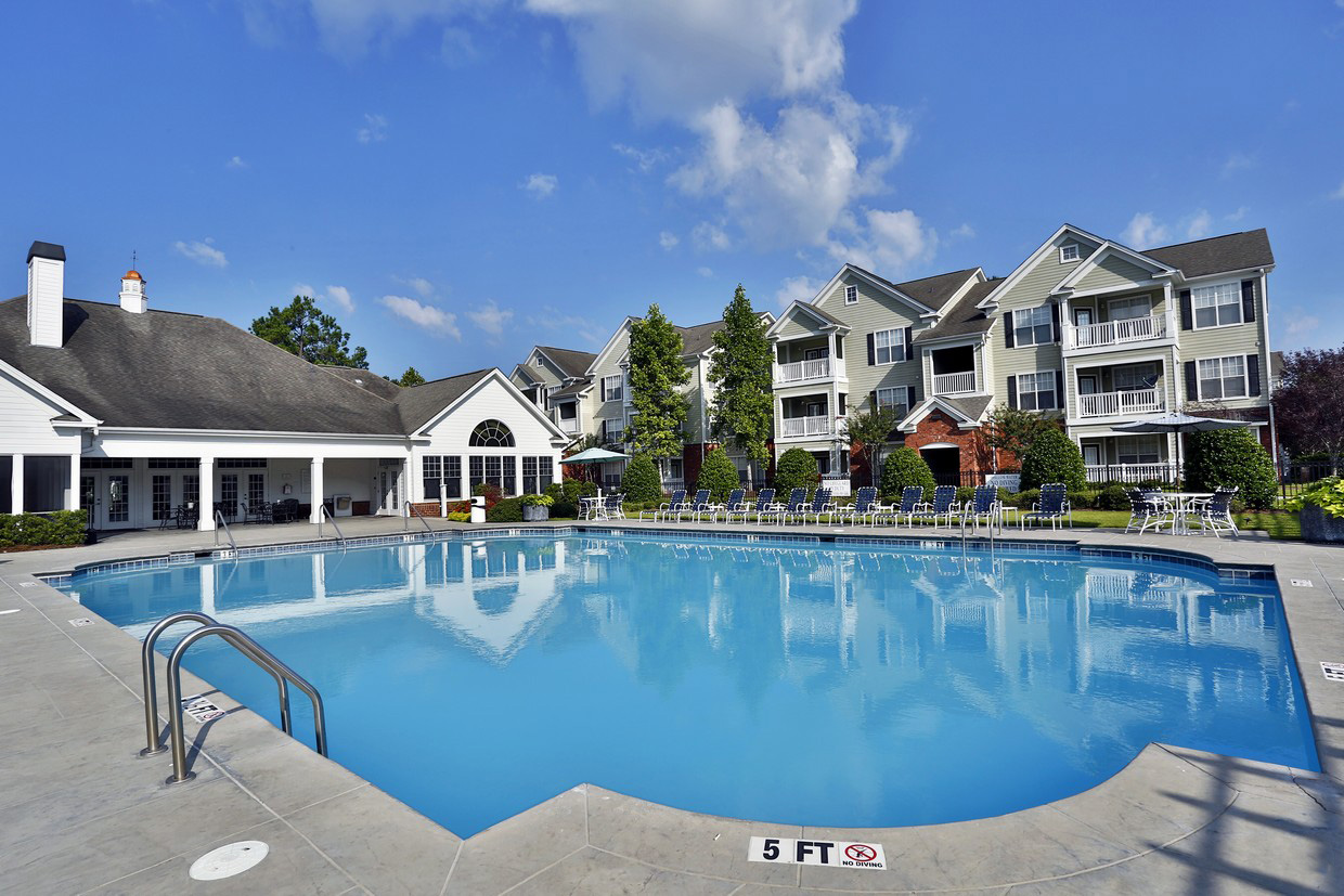 Outdoor Pool and clubhouse at the Tradition at Summerville corporate rentals in Summerville, SC